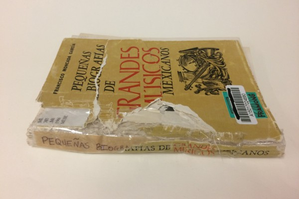 "This was a book that was damaged by a dog, and ""fixed"" with packing tape by a patron."